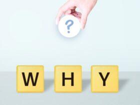 「WHY」の文字と「?」