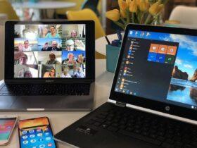 タブレットとモバイルPC、スマートフォンの画面。ビデオ会議の様子。